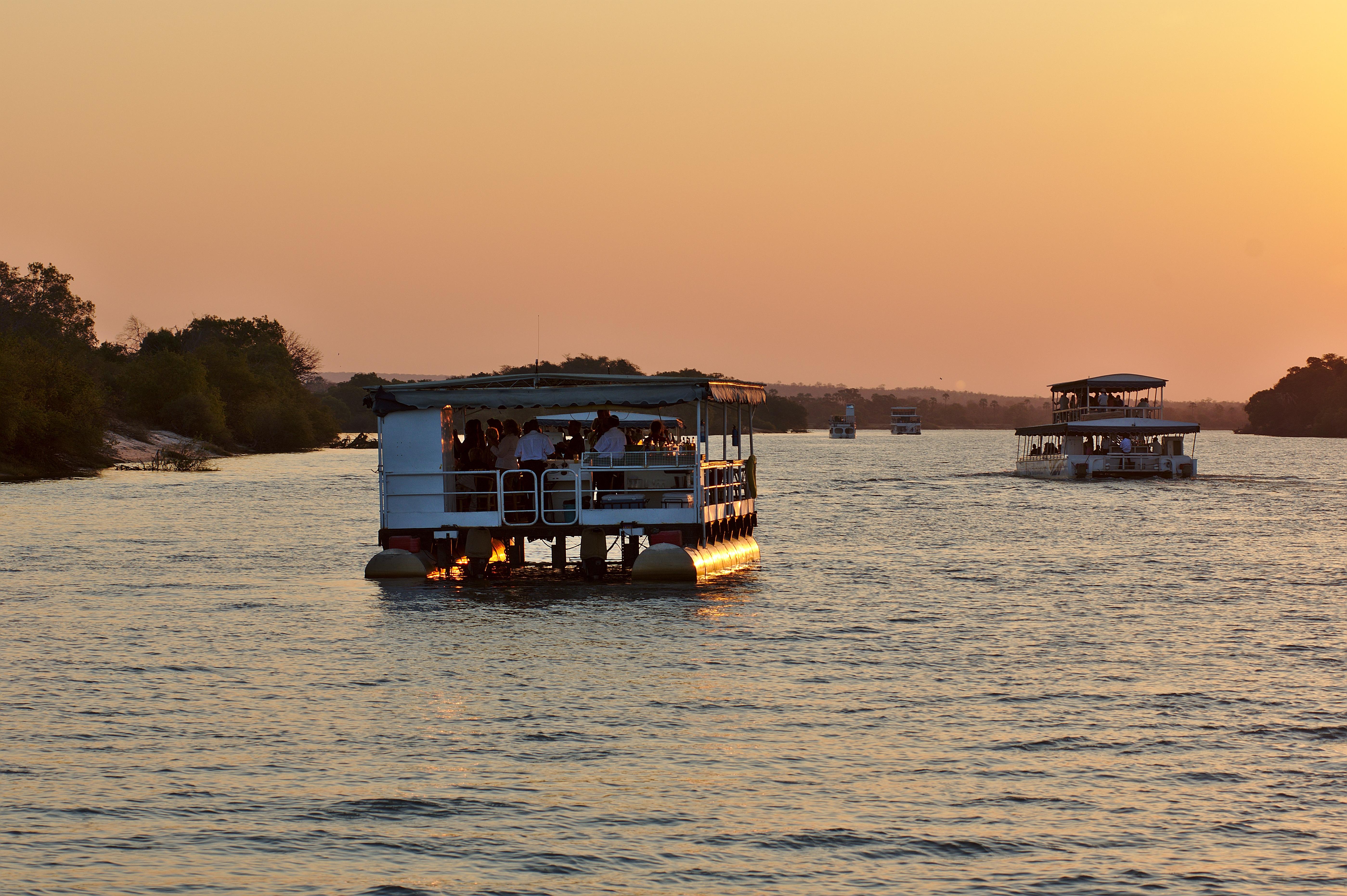 Two safari ships cruising Zambezi river. Victoria Falls, Zimbabwe Africa.